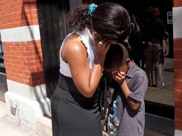 Suzanne Beatty comforts her son, Quentin Beatty, 7, on a street in New York's TriBeCa neighborhood  after a 5.9 earthquake struck on Aug. 23, 2011.