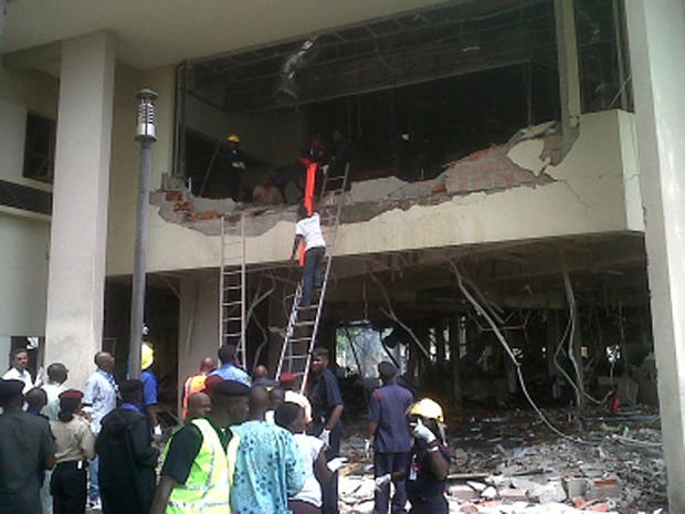 firefighters and rescue workers after a large explosion struck the United Nations' main office in Nigeria's capital Abuja