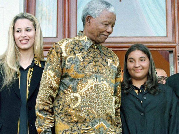 Nelson Mandela with Muammar Qaddafi's daughters