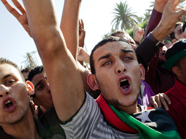 People celebrate at Martyrs' Square, formerly known as Green Square, for the Eid Al-Fitr prayer Aug. 31, 2011, in Tripoli, Libya. Libyans celebrated the first Eid Al-Fitr in 42 years under a new regime.