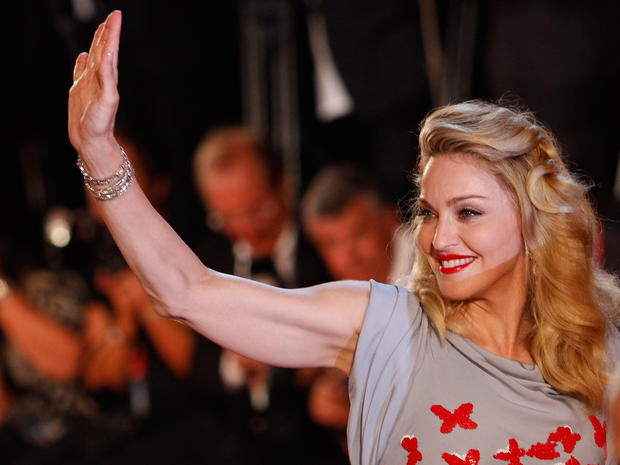 "Singer Madonna waves to her fans as she arrives for the premiere of her movie ""W.E."" at the Venice Film Festival on Sept. 1, 2011."