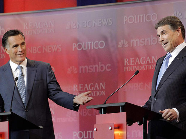 Republican presidential candidates former Massachusetts Gov. Mitt Romney, left, and Texas Gov. Rick Perry answer a question during a Republican presidential candidate debate at the Reagan Library, Sept. 7, 2011, in Simi Valley, Calif.