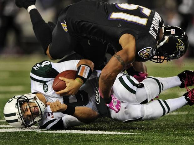 BALTIMORE, MD - OCTOBER 2: Quarterback Mark Sanchez #6 of the New York Jets is hit by linebacker Brendon Ayanbadejo #51 of the Baltimore Ravens during the second quarter at M&T Bank Stadium on October 2, 2011 in Baltimore, Maryland. (Photo by Patrick Smith/Getty Images)