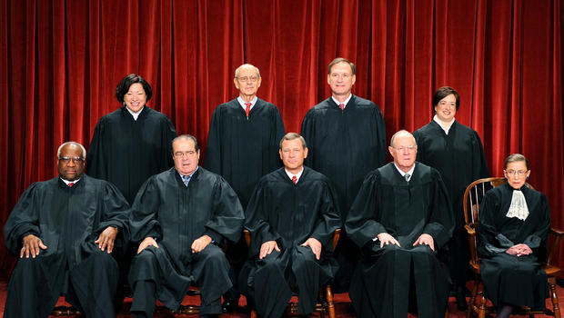 The justices of the U.S. Supreme Court sit for their official photograph Oct. 8, 2010, at the Supreme Court in Washington. From left to right, front row: Associate Justice Clarence Thomas, Associate Justice Antonin Scalia, Chief Justice John G. Roberts, A