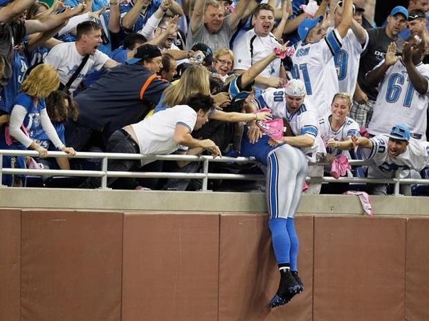 DETROIT, MI - OCTOBER 10: Calvin Johnson #81 of the of the Detroit Lions celebrates his touchdown reception by leaping into the stands during their game against the Chicago Bears at Ford Field on October 10, 2011 in Detroit, Michigan. (Photo by Gregory Shamus/Getty Images)