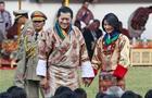 Bhutan King Jigme Khesar Namgyal Wangchuck, center left, and Queen Jetsun Pema meet locals after they were married Thursday