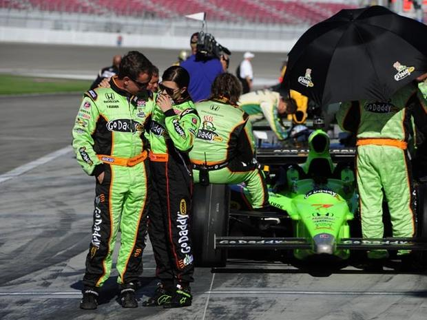 LAS VEGAS - OCTOBER 16: Danica Patrick, driver of the #7 Andretti Autosport Dallara Honda, is consoled by a crew member after Dan Wheldon of England was pronounced dead after he was involved in a 15 car massive crash during the Las Vegas Indy 300 part of the IZOD IndyCar World Championships presented by Honda on October 16, 2011 at the Las Vegas Motor Speedway in Las Vegas, Nevada. (Photo by Robert Laberge/Getty Images)