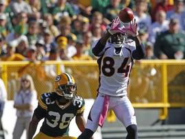 GREEN BAY, WI - OCTOBER 2: Brandon Lloyd #84 of the Denver Broncos makes a catch while being covered by Tramon Williams #38 of the Green Bay Packers at Lambeau Field on October 2, 2011 in Green Bay, Wisconsin. (Photo by Matt Ludtke /Getty Images)