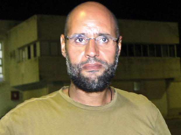 Saif al-Islam Qaddafi, son of ousted Libyan leader Muammar Qaddafi, appears in front of journalists at his father's residential complex in the Libyan capital of Tripoli Aug. 23, 2011.