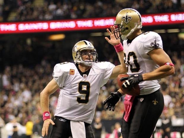 NEW ORLEANS, LA - OCTOBER 23: Jimmy Graham #80 of the New Orleans Saints is congratulated by quarterback Drew Brees #9 after scoring a touchdown during the game against the Indianapolis Colts on October 23, 2011 at Mercedes-Benz Superdome in New Orleans, Louisiana. (Photo by Jamie Squire/Getty Images)