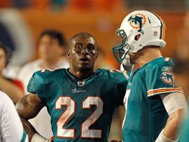 MIAMI GARDENS, FL - SEPTEMBER 12: Reggie Bush #22 and Chad Henne #7 of the Miami Dolphins talk during a game against the New England Patriots at Sun Life Stadium on September 12, 2011 in Miami Gardens, Florida. (Photo by Mike Ehrmann/Getty Images)