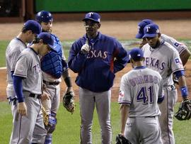 ST LOUIS, MO - OCTOBER 27: Manager Ron Washington of the Texas Rangers stands on the mound after removing Colby Lewis #48 in the sixth inning during Game Six of the MLB World Series against the St. Louis Cardinals at Busch Stadium on October 27, 2011 in St Louis, Missouri. (Photo by Rob Carr/Getty Images)