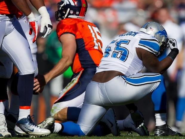 DENVER, CO - OCTOBER 30: Linebacker Stephen Tulloch #55 of the Detroit Lions reacts by 'Tebowing' after making a sack on quarterback Tim Tebow #15 of the Denver Broncos during the first quarter at Sports Authority Field at Mile High on October 30, 2011 in Denver, Colorado. (Photo by Justin Edmonds/Getty Images)