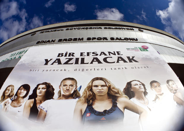 A large poster shows the competitors in the WTA championship finals in Istanbul, Turkey, Thursday, Oct. 27, 2011, on the facade of the tournament venue, the Sinan Erdem sports hall