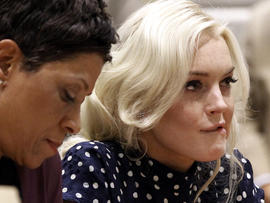 Actress Lindsay Lohan, right, bites her lip as she appears with her attorney Shawn Chapman Holley at a probation hearing in Los Angeles Superior Court Nov. 2, 2011. Judge Stephanie Sautner sentenced Lohan to 30 days in jail and warned the actress there would be plenty more time behind bars if she violated further court orders. The actress has until Nov. 9, 2011, to report for her jail term, and Sautner ruled she cannot serve house arrest, as she did previously.