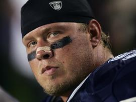 LANDOVER, MD - SEPTEMBER 27: Defensive tackle Chad Eaton #99 of the Dallas Cowboys watches from the sideline during the game with the Washington Redskins at FedEx Field on September 27, 2004 in Landover, Maryland. The Cowboys defeated the Redskins 21-18. (Photo by Doug Pensinger/Getty Images)