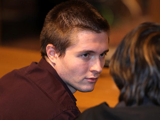 Raffaele Sollecito waits in Perugia's Court of Appeal Oct. 3, 2011, in Perugia, Italy, before hearing that he won his appeal against his murder conviction.