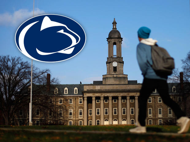 A students walks in front of the Old Main building on the Penn State campus Friday, Nov. 11, 2011, in State College, Pa. The Penn State University board of trustees who fired legendary football coach Joe Paterno and school president Graham Spanier are meeting Friday in the wake of the massive shakeup prompted by a child sex-abuse scandal.