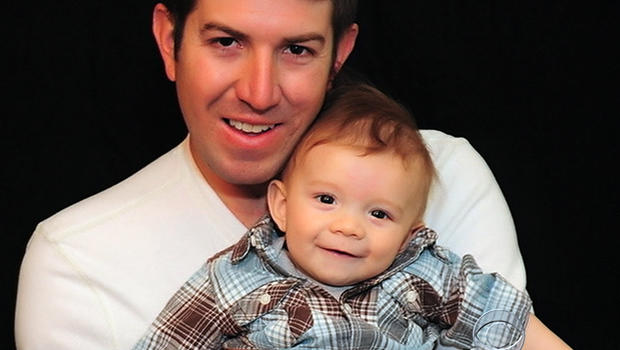 Ryan Kules poses for a picture with one of his children in an undated family photo.