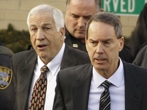 Former Penn State University assistant football coach Jerry Sandusky, left, walks with his attorney Joe Amendola, right, as he leaves the Centre County Courthouse after waiving a preliminary hearing Tuesday, Dec. 13, 2011 in Bellefonte, Pa.