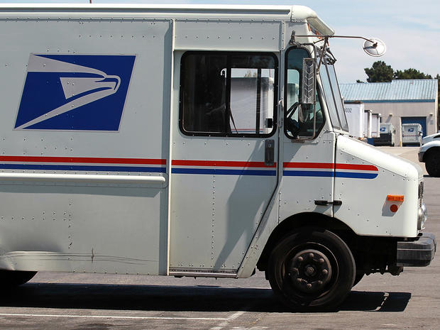 U.S. Postal Service trucks are seen parked near the loading dock at the U.S. Post Office sort center Aug. 12, 2011, in San Francisco.
