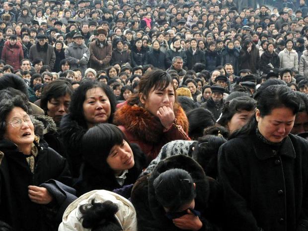 North Koreans grieve as they visit a portrait of the late leader Kim Jong Il at Kim Il Sung Square in Pyongyang, North Korea, Dec. 21, 2011.