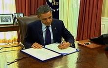 Obama signs payroll tax cut extension