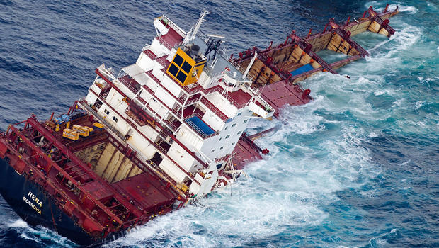 Half of cargo ship sinking off New Zealand - CBS News
