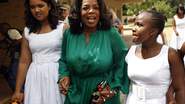 Oprah Winfrey walks with honor graduates after the first graduation ceremony at Oprah Winfrey's leadership academy for girls in Henley on Klip, South Africa, Saturday Jan. 14, 2012. Winfrey said the first students to graduate from her academy for underpri