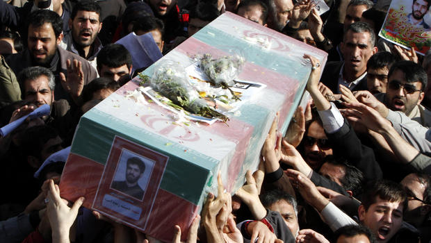 Iranians carry Jan. 13, 2012, the flag-draped coffin of Mostafa Ahmadi Roshan, a chemistry expert and a director of the Natanz uranium enrichment facility who was killed in a brazen daylight assassination, in Tehran, Iran.