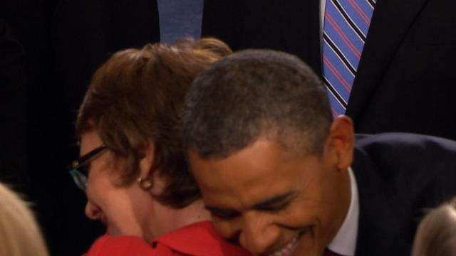 Obama greets Giffords with big hug