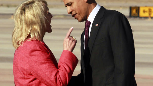 Arizona Gov. Jan Brewer points during an intense conversation with President Barack Obama after he arrived at Phoenix-Mesa Gateway Airport, Wednesday, Jan. 25, 2012, in Mesa, Ariz. Asked moments later what the conversation was about, Brewer, a Republican,