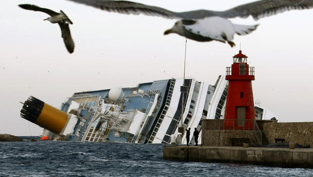 Seagulls fly in front of the grounded cruise ship Costa Concordia off the Tuscan island of Giglio, Italy, Jan. 30, 2012. Residents of Giglio are growing increasingly worried about threats to the environment and the future of the island as bad weather agai