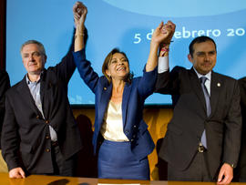 Mexican presidential candidate Josefina Vazquez Mota celebrates her victory with her counterparts Santiago Creel, left, and Ernesto Cordero from the National Action Party during a press conference in Mexico City Feb. 5, 2012.