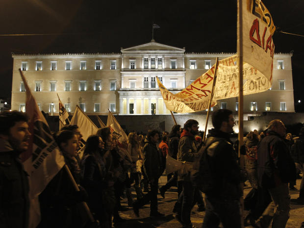 Protesters rally against austerity measures in front of the Greek Parliament