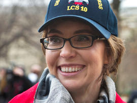 Former Arizona Rep. Gabrielle Giffords attends a ceremony at the Pentagon, Friday, Feb. 10, 2012, for the unveiling of the USS Gabrielle Giffords. The Navy has named a ship for Gabrielle Giffords, the recently retired congresswoman from Arizona who is recovering from a gunshot wound to the head received in January 2011