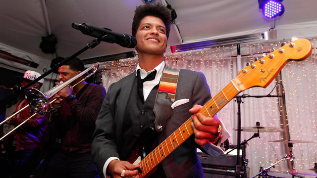Musician Bruno Mars performs during the Warner Music Group Grammy Celebration hosted by InStyle