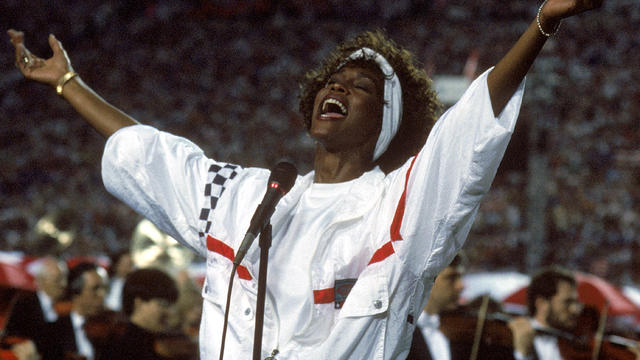 Whitney Houston sings the National Anthem prior to Super Bowl XXV with the New York Giants taking on the Buffalo Bills at Tampa Stadium Jan. 27, 1991, in Tampa, Fla. The Giants won 20-19.