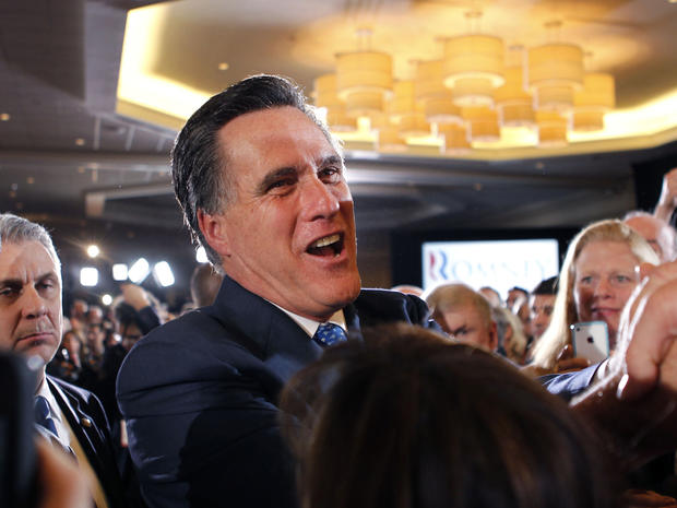 Mitt Romney greets supporters at his election night party in Boston