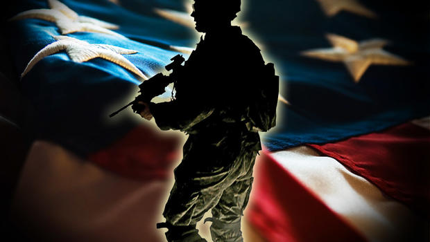 Silhouette of US Army soldier with weapon, over US flag