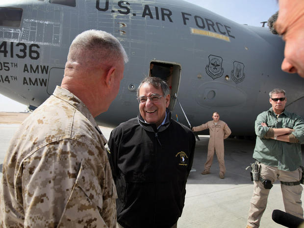 Defense Secretary Leon Panetta is greeted upon his arrival at Camp Bastion