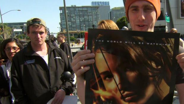 "Fans show off their ""Hunger Games"" memorabilia."