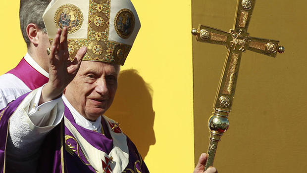 Pope Benedict XVI waves to faithful as arrives to lead a Mass at Revolution Square in Havana, Cuba, March 28, 2012.