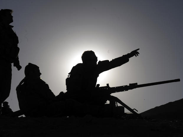 Australian soldiers of the Omlet-c Company fix their target prior to practice firing at their forward operating base in Mirwais, Afghanistan, Jan. 20, 2010.