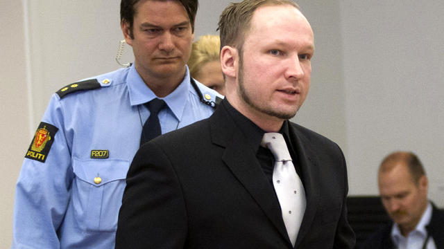 Right-wing extremist Anders Behring Breivik walks to take his seat in the witness box at the central court in Oslo, Norway, April 20, 2012.