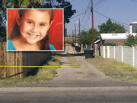 An alley path behind the street where 6-year-old Tucson girl Isabel Mercedes Celis went missing from her home is cut off with police tape in Tucson, Ariz., April 22, 2012.