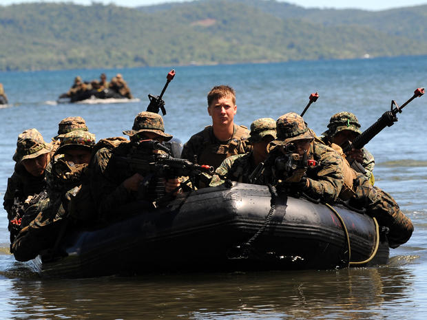 U.S. and Filipino soldiers are seen on a boat during a joint mock beachfront assault on the shore of Ulugan Bay on Palawan island in the Philippines April 25, 2012.