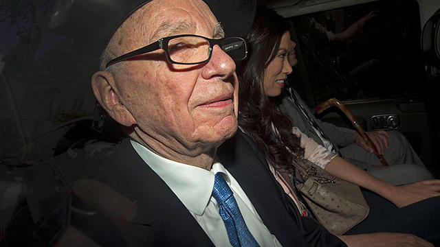 News Corp Chief Rupert Murdoch, left, his wife Wendi and son Lachlan are driven away from the High Court in central London on April 26, 2012 after Murdoch's second and final day of giving evidence at the Leveson Inquiry.