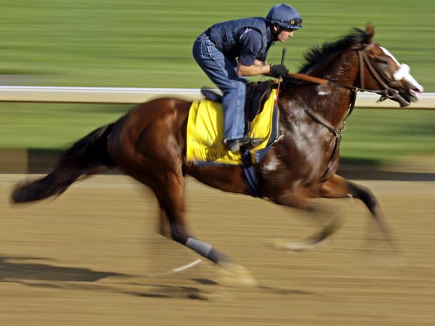 Exercise rider Peter Brette takes Kentucky Derby entrant Union Rags for a workout at Churchill Downs May 2, 2012, in Louisville, Ky.