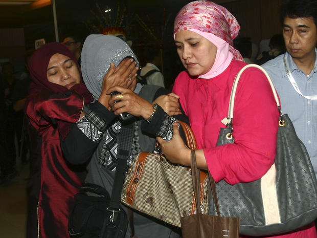 A relative weeps after inspecting the list of passengers reportedly on board a missing Russian airplane at Halim Perdanakusuma Airport in Jakarta, Indonesia, May 9, 2012.